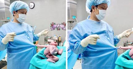 嬰兒一出生嚎哭還「單手緊抓手術袍」 網笑:睡到一半被拉出來,起床氣很重